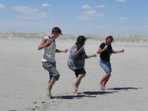 Rose Simpson, Marian Naranjo, and Roxanne Swentzell joyously dancing after harvesting salt